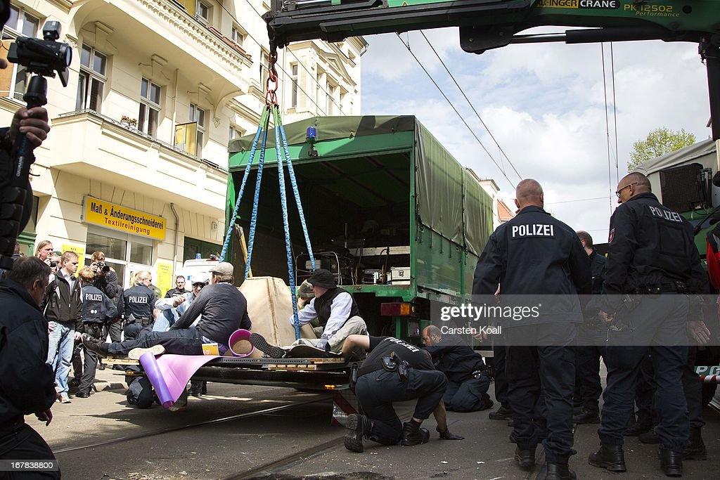 Leftist demonstrators who had tied themselves together to prevent a neonazi demonstration are moved by police on May Day on May 1 2013 in Berlin...