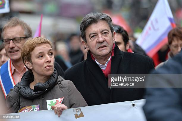 Leftist Front de Gauche leader JeanLuc Melenchon and spokesperson of French Left party Ensemble Clementine Autain march during a demonstration in...