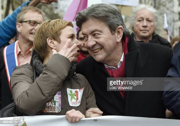 Leftist Front de Gauche leader JeanLuc Melenchon listens to spokesperson of French Left party Ensemble Clementine Autain as they march during a...