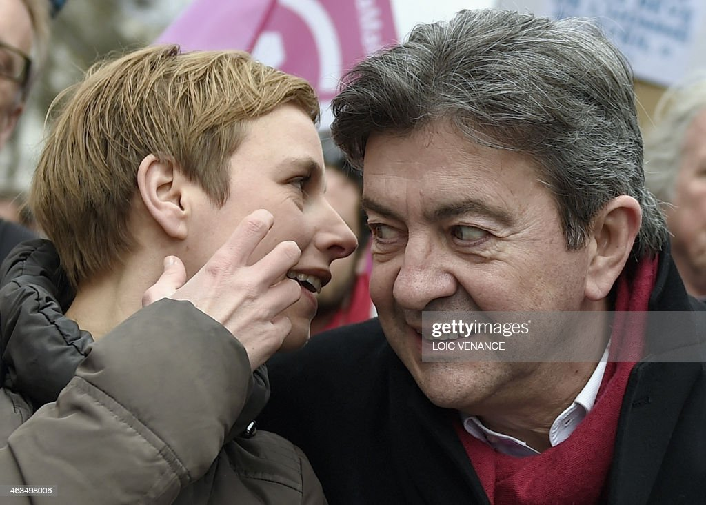 Leftist Front de Gauche (FG) leader <a gi-track='captionPersonalityLinkClicked' href=/galleries/search?phrase=Jean-Luc+Melenchon&family=editorial&specificpeople=635097 ng-click='$event.stopPropagation()'>Jean-Luc Melenchon</a> (R) listens to spokesperson of French Left party Ensemble (Together) Clementine Autain as they march during a demonstration in support of the Greek people on February 15, 2015 in Paris. At least 2,000 people marched through the streets of Paris on February 15 heeding the call from unions and far-left organisations to voice their support for Greece and its new leftist anti-austerity government. AFP PHOTO / LOIC VENANCE