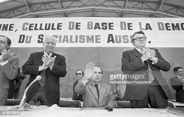 Gaston Deferre Francois Mitterrand and Pierre Mauroy applaud during the French Socialist Party's extraordinary congress in 1976 The Leftists came...