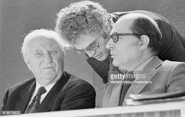 Leftist leaders Gaston Deferre Lionel Jospin and Francois Mitterrand talk privately during the French Socialist Party's extraordinary congress in...