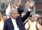 Leftist presidential candidate Andres Manuel Lopez Obrador waves to supporters gathered in Mexico City's main square during the closing rally of the...