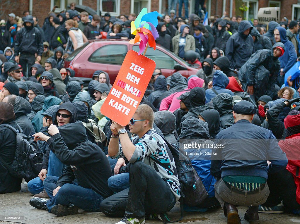 Leftist protesters blockade a street junction during a march by neoNazis on June 2 2012 in Hamburg Germany Thousands of protesters took to the...