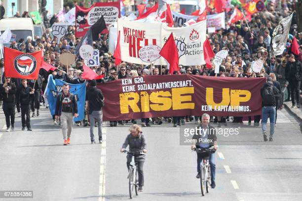 Leftist protesters carrying signs condemning the upcoming G20 summit march in annual May Day demonstrations on May 1 2017 in Hamburg Germany Hamburg...
