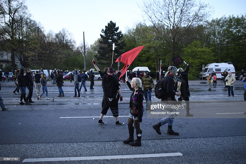 Leftist protesters march on May Day after clashing with police forces on 01 May, 2016 in Hamburg, Germany. Tens of thousands of people across Germany participated in marches and gatherings by labor unions and in some cities left-wing and anarchist activists took to the streets under heavy oversight by police.