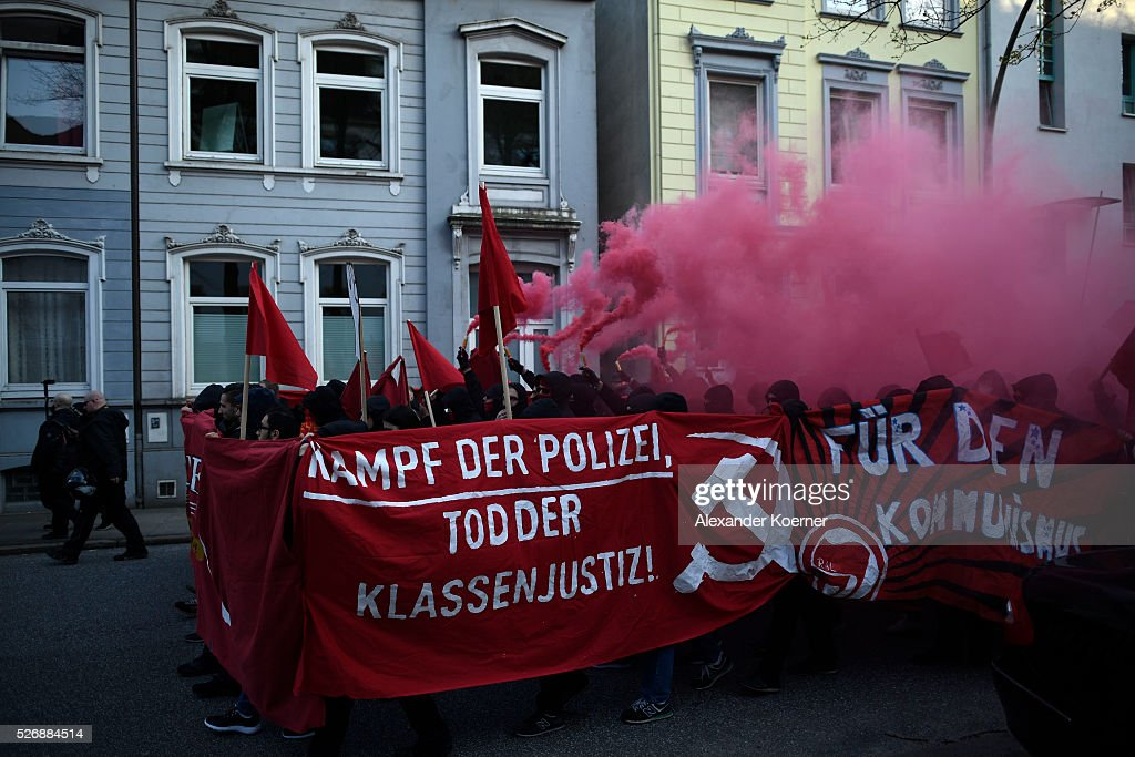 Leftist protesters march on May Day on 01 May, 2016 in Hamburg, Germany. Tens of thousands of people across Germany participated in marches and gatherings by labor unions and in some cities left-wing and anarchist activists took to the streets under heavy oversight by police.
