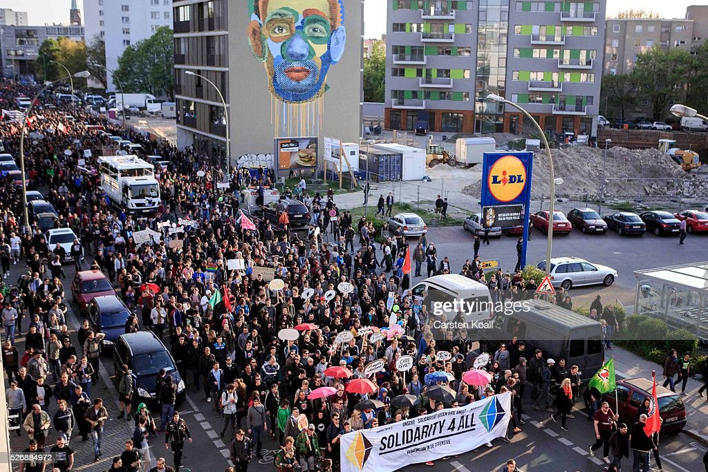 Leftist protesters march on May Day on May, 2016 in Berlin, Germany. Tens of thousands of people across Germany participated in marches and gatherings by labor unions and in some cities left-wing and anarchist activists took to the streets under heavy oversight by police. In Berlin far-right protesters also attempted to hold rallies during the day.
