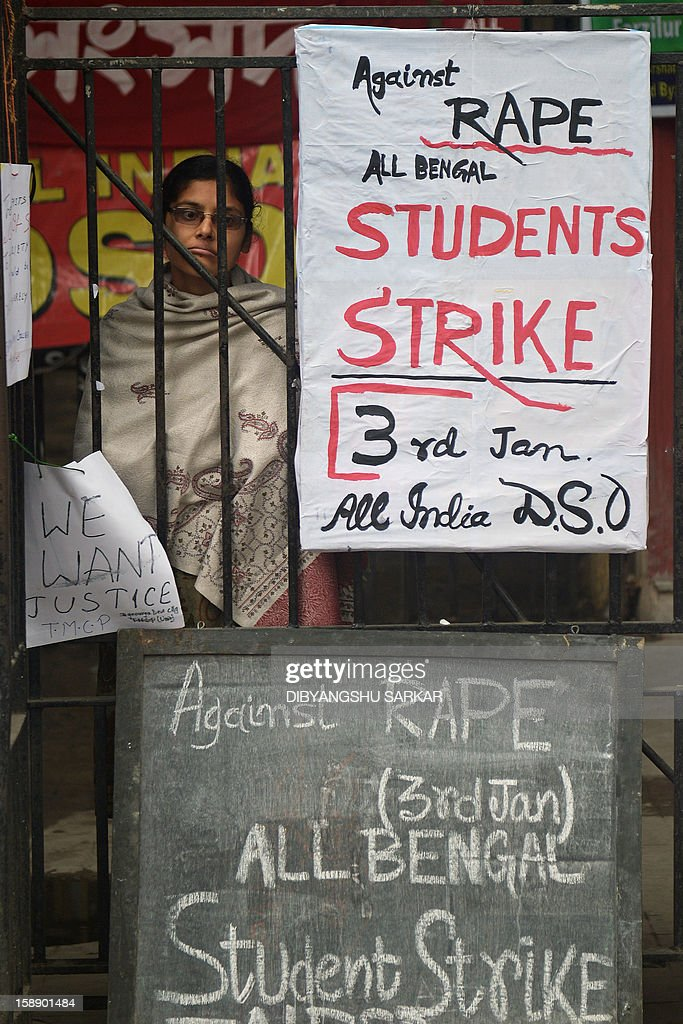 A leftist student activist looks on besides placards, calling for a statewide student strike against rape, in front of a government college in Kolkata on January 3, 2013. Protesters have massed in Indian cities daily since the December 16 assault demanding the government and police take sex crime more seriously, with tougher penalties for offenders and even chemical castration being considered. Indian police formally charged five men with murder, kidnapping and rape January 3 in a New Delhi court over the fatal gang-raping of a woman that has appalled the nation. AFP PHOTO/Dibyangshu SARKAR