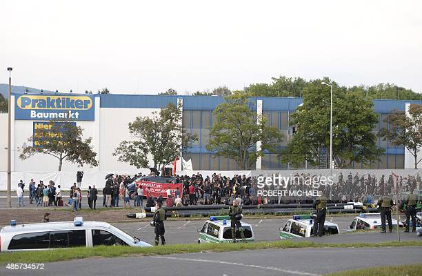 Leftist sympathizers pass by a shelter for asylum seekers on August 29 2015 in Heidenau eastern Germany Heidenau a town of around 16000 inhabitants...