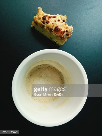 Leftovers Of Coffee And Cake Over Blue Background