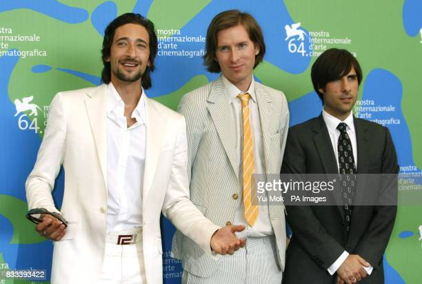 Leftright Adrien Brody director Wes Anderson and Jason Schwartzman during a photocall for the film 'The Darjeeling Limited' at the Venice Film...