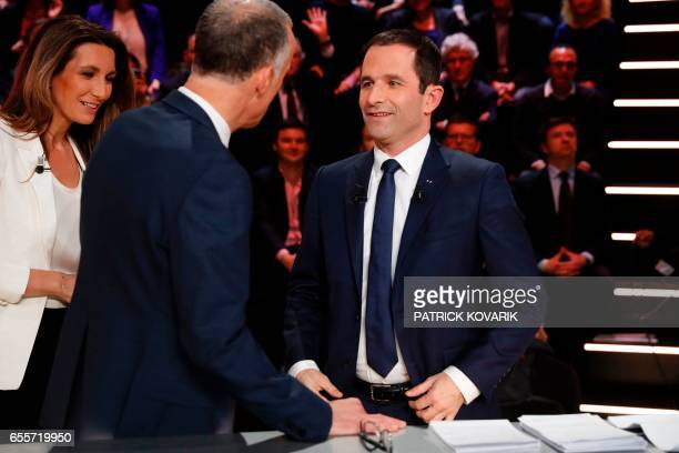 Leftwing French Socialist party Benoit Hamon speak with journalists Gilles Bouleau and AnneClaire Coudray before taking part in a debate between five...
