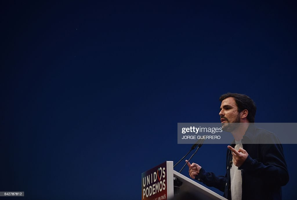 Left-wing party IU leader Alberto Garzon speaks during the Unidos Podemos partys final campaign meeting in Madrid on June 24, 2016 ahead of the June 26 general election. Spain votes again on June 26, six months after an inconclusive election which saw parties unable to agree on a coalition government. GUERRERO