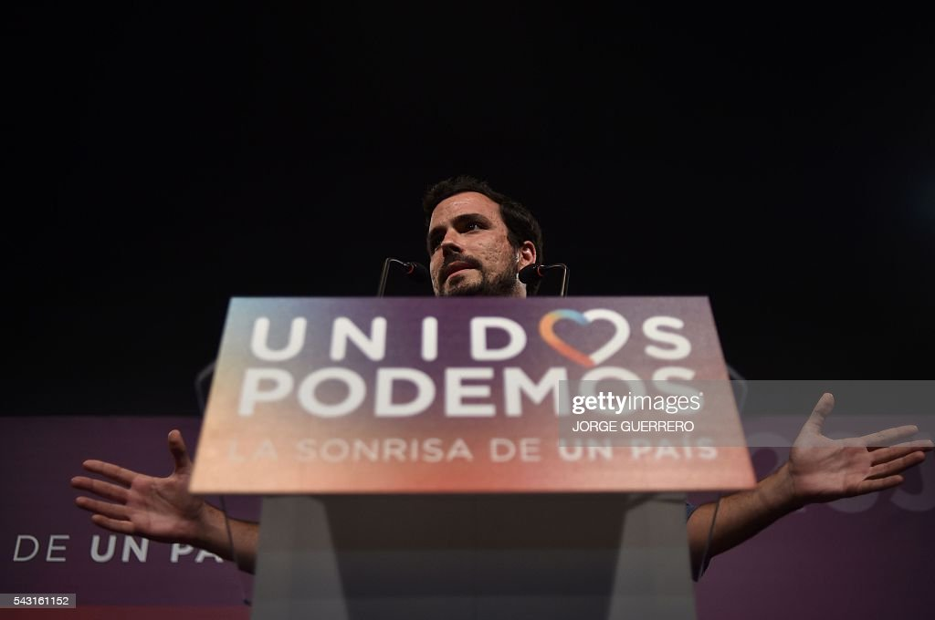 Left-wing party IU leader and one of the leaders of far-left formation Unidos Podemos Alberto Garzon delivers a speech before the official results of Spain's general election in Madrid on June 26, 2016. Spain's repeat polls ended on June 26 with the incumbent conservatives appearing to have scored a small win tailed closely by a far-left coalition led by Podemos, exit polls said, against a backdrop of record/low abstention. / AFP / JORGE