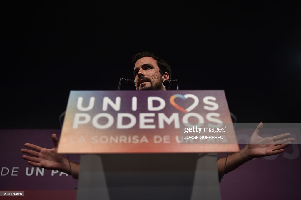 Left-wing party IU leader and one of the leaders of far-left formation Unidos Podemos Alberto Garzon delivers a speech before the official results of Spain's general election in Madrid on June 26, 2016. Spain's second elections in six months was due to conclude on June 26 in much the same way as they did in December, with the incumbent conservatives winning tailed by the Socialist party, partial results showed. / AFP / JORGE