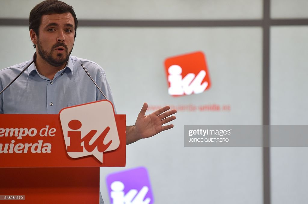 Left-wing party IU leader and one of the leaders of far-left formation Unidos Podemos, Alberto Garzon gestures during a press conference held one day after the Spanish general elections, at the IU headquarters in Madrid, on Juny 27, 2016. Spain hoped on June 27 that repeat weekend elections would unblock the country's political paralysis after the conservatives came out strengthened with more seats, although they still face resistance from hostile rivals. / AFP / JORGE