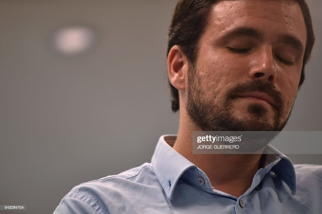 Left-wing party IU leader and one of the leaders of far-left formation Unidos Podemos, Alberto Garzon closes his eyes during a press conference held one day after the Spanish general elections, at the IU headquarters in Madrid, on Juny 27, 2016. Spain hoped on June 27 that repeat weekend elections would unblock the country's political paralysis after the conservatives came out strengthened with more seats, although they still face resistance from hostile rivals. / AFP / JORGE
