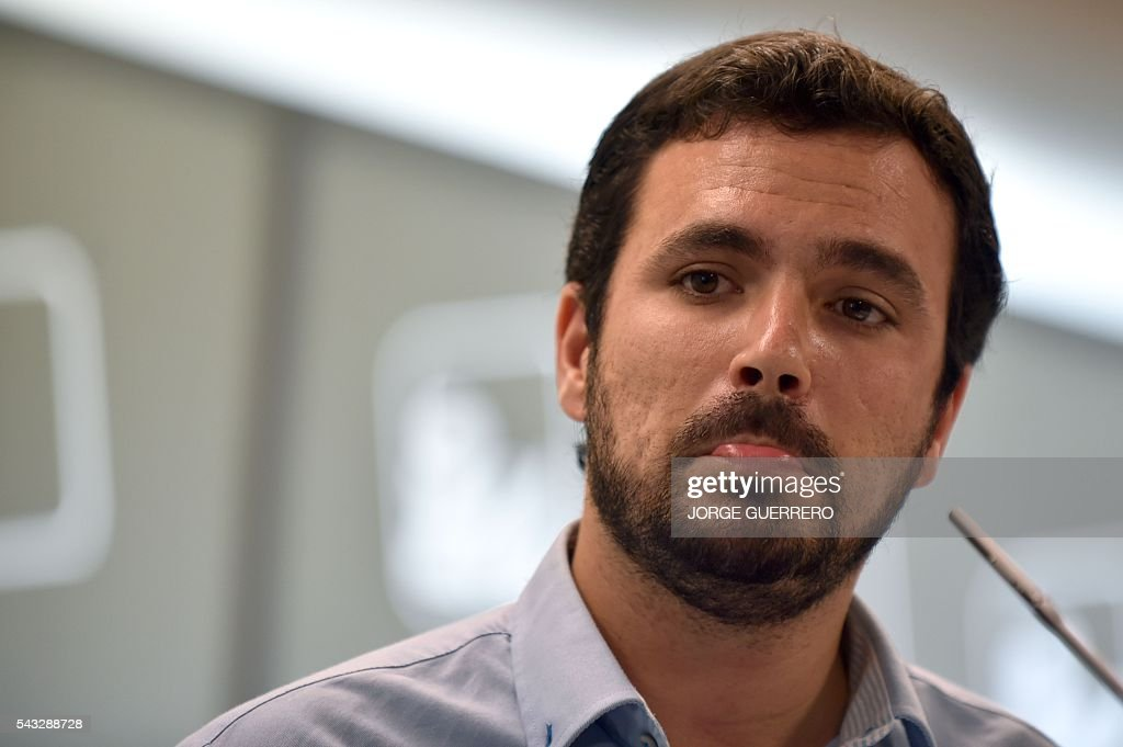 Left-wing party IU leader and one of the leaders of far-left formation Unidos Podemos, Alberto Garzon looks on during a press conference held one day after the Spanish general elections, at the IU headquarters in Madrid, on June 27, 2016. Spain hoped on June 27 that repeat weekend elections would unblock the country's political paralysis after the conservatives came out strengthened with more seats, although they still face resistance from hostile rivals. / AFP / JORGE