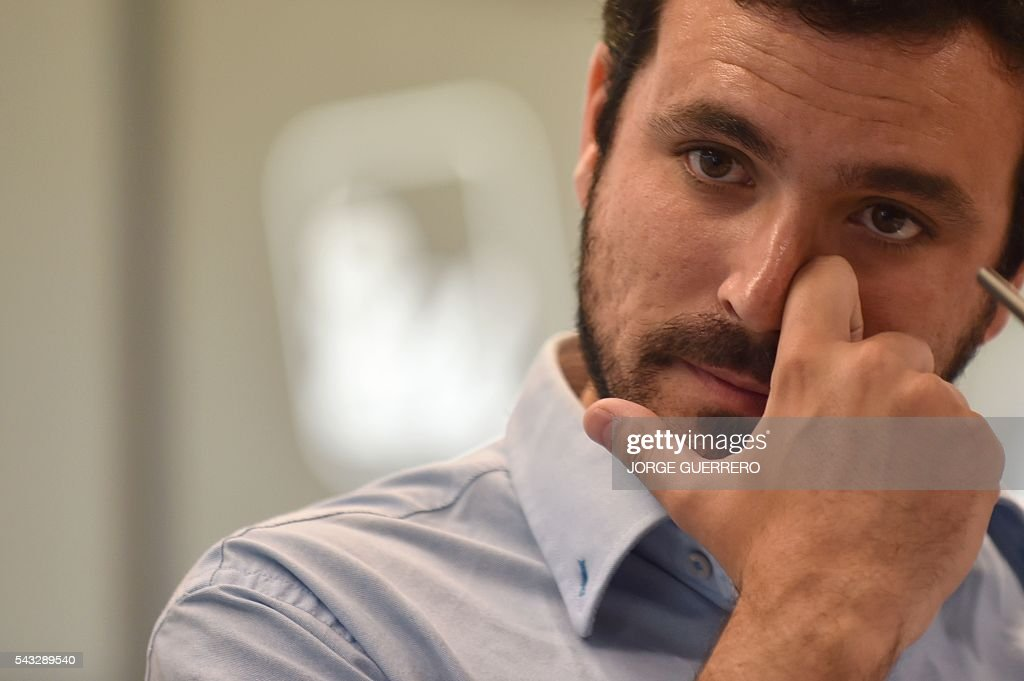 Left-wing party IU leader and one of the leaders of far-left formation Unidos Podemos, Alberto Garzon gestures during a press conference held one day after the Spanish general elections, at the IU headquarters in Madrid, on June 27, 2016. Spain hoped on June 27 that repeat weekend elections would unblock the country's political paralysis after the conservatives came out strengthened with more seats, although they still face resistance from hostile rivals. / AFP / JORGE