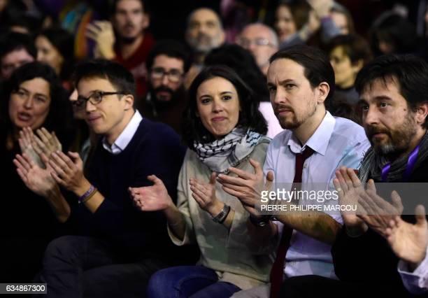Leftwing party Podemos leader Pablo Iglesias Podemos member Irene Montero and Podemos' spokesman Inigo Errejon clap during the closing of a decisive...