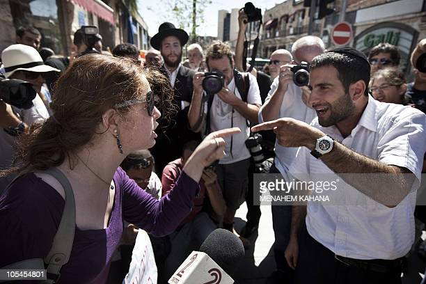 A leftwing protester argues with an ultraOrthodox Jewish man during a protest by antireligious movement activists on September 29 2010 on the roads...