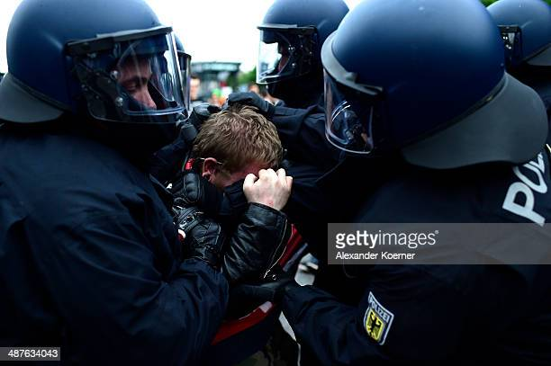 A leftwing protester clashes with police on May 1 2014 in Hamburg Germany Leftwing activists from across Germany gathered in Hamburg today to take...