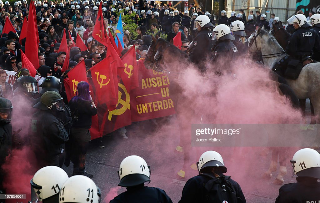 Left-wing protesters clash with police in Altona district on May Day on May 1, 2013 in Hamburg, Germany. May Day, the international day of labour, is a national holiday in Germany and observed with gatherings by labour unions and political parties. In some cities, including Hamburg and Berlin, the day often ends with violent clahes between police and mostly left-wing demonstrators.