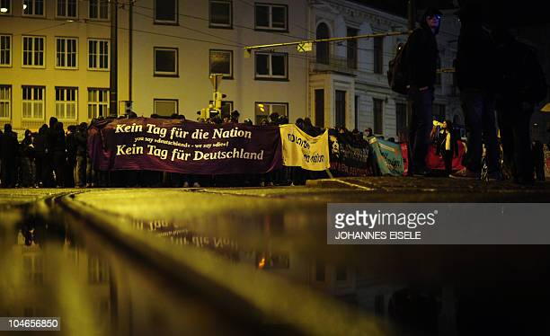 Leftwing protestors of the socalled black block hold a banner during a demonstration against the reunification celebrations on October 2 2010 in the...