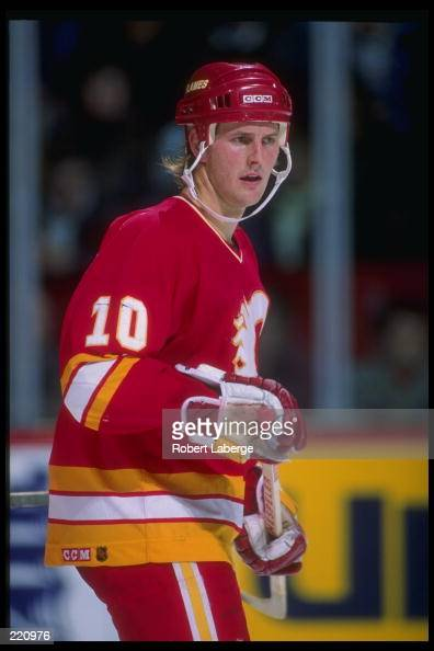 Leftwinger Gary Roberts of the Calgary Flames looks on during a game against the Montreal Canadiens at the Montreal Forum in Montreal Quebec...