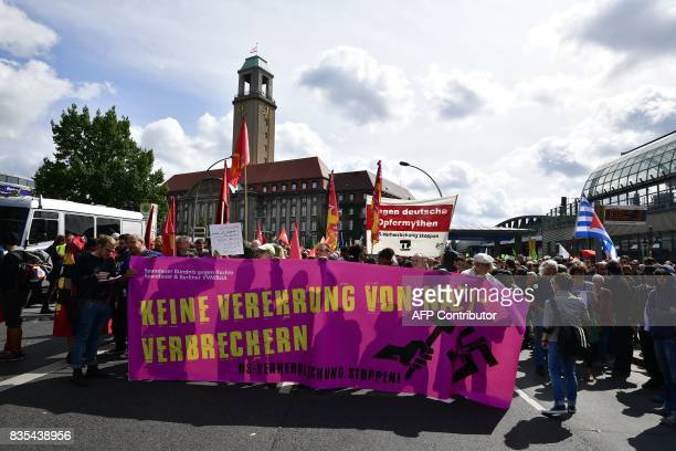 Leftwings demonstrators hold a banner reading 'No veneration for Nazi criminals' during a demonstration against the neonazi march on the occasion of...