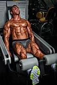 body builder train legs at gym
