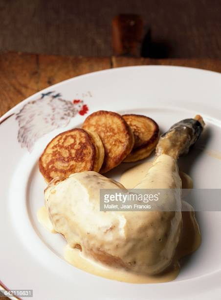 Leg of poultry and cream Fricasse with small potato galettes