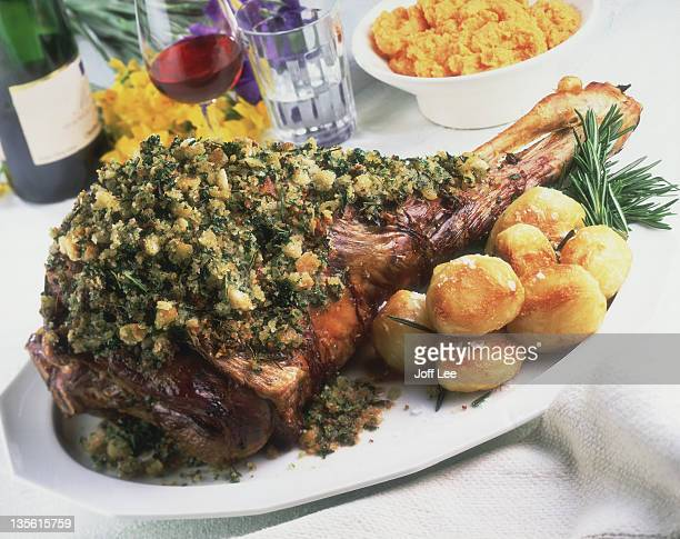 Leg of roast lamb with stuffing and roast potatoes