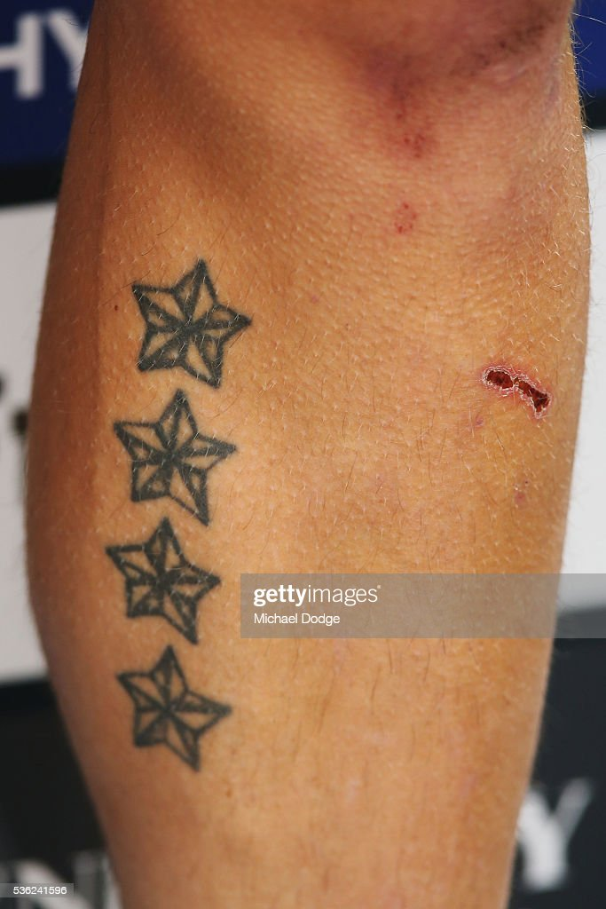 A leg tattoo is seen on Zach Tuohy of the Blues as he speaks to media during the Carlton Blues AFL training session at Ikon Park on June 1, 2016 in Melbourne, Australia.