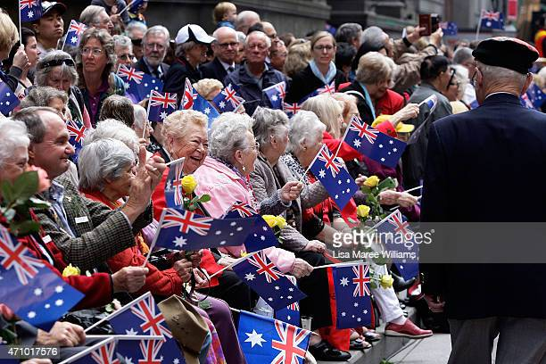 Legacy War Widows cheer and wave roses as servicemen and women march along George Street during the Anzac Day Parade on April 25 2015 in Sydney...