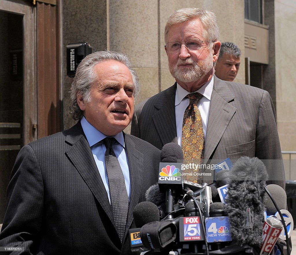 Legal counsel for former IMF head Dominique Strauss-Kahn, <a gi-track='captionPersonalityLinkClicked' href=/galleries/search?phrase=Benjamin+Brafman&family=editorial&specificpeople=2776479 ng-click='$event.stopPropagation()'>Benjamin Brafman</a> and William Taylor (R) briefly speak to the media as they depart the NY District Attorney's office on July 6, 2011 in New York City.