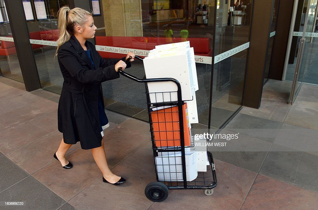 Legal documents are wheeled into the Supreme Court of New South Wales building in Sydney on October 9, 2013, as a case at the court continues with Australian billionaire Gina Rinehart's children taking their mining mogul mother to court over the multi-billion dollar family trust in a long-running and bitter feud in which she is accused of acting deceitfully. Rinehart's two eldest children, John Hancock and Bianca Rinehart are seeking her removal as head of the trust, set up by her late father Lang Hancock in 1988 and worth at least Aus$5 billion (US$4.7 billion). AFP PHOTO/William WEST