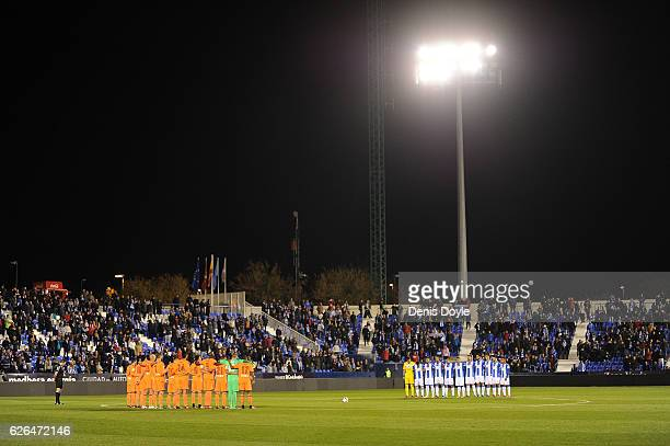 Leganes and Valencia CF players hold a minute of silence for the victims of the plane carrying Brazilian Chapecoense football team which crashed...