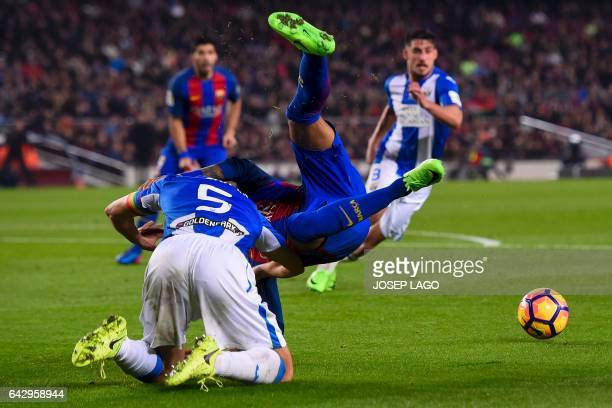 Leganes' Argentinian defender Martin Mantovani vies with Barcelona's Brazilian forward Neymar during the Spanish league football match FC Barcelona...