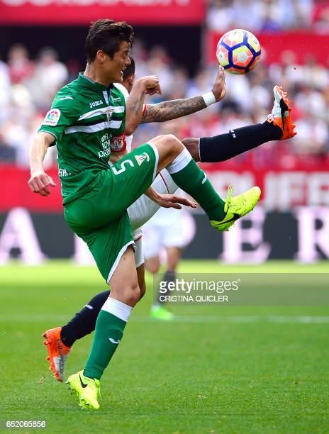 Leganes' Argentinian defender Martin Mantovani vies with Sevilla's Argentinian midfielder Matias Kranevitter during the Spanish league football match...