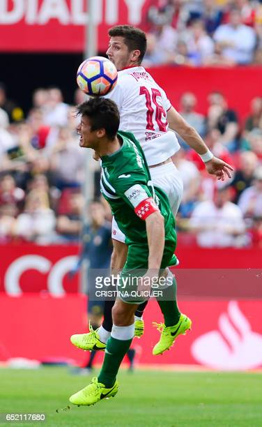 Leganes' Argentinian defender Martin Mantovani vies with Sevilla's Montenegrin forward Stevan Jovetic during the Spanish league football match...