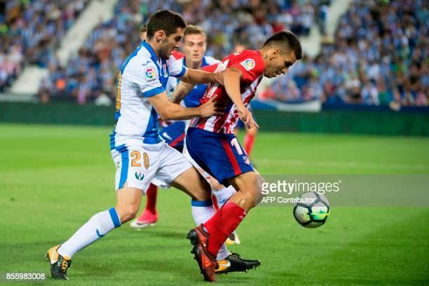 Leganes' defender from Spain Joseba Zaldua Bengoetxea vies with Atletico Madrid's forward from Argentina Angel Correa during the Spanish league...