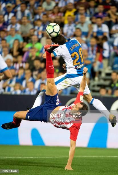 Leganes' defender from Spain Joseba Zaldua Bengoetxea vies with Atletico Madrid's defender from Uruguay Diego Godin during the Spanish league...