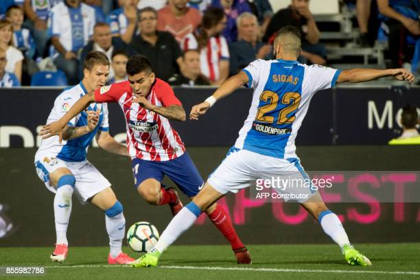 Leganes' defender from Spain Raul Garcia Carnero and Leganes' defender from Greece Dimitrios Siovas vie with Atletico Madrid's forward from Argentina...