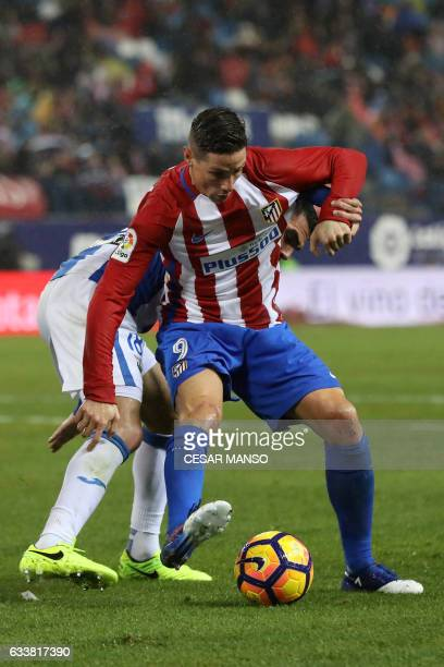 Leganes' defender Pablo Insua vies with Atletico Madrid's forward Fernando Torres during the Spanish league football match Club Atletico de Madrid vs...