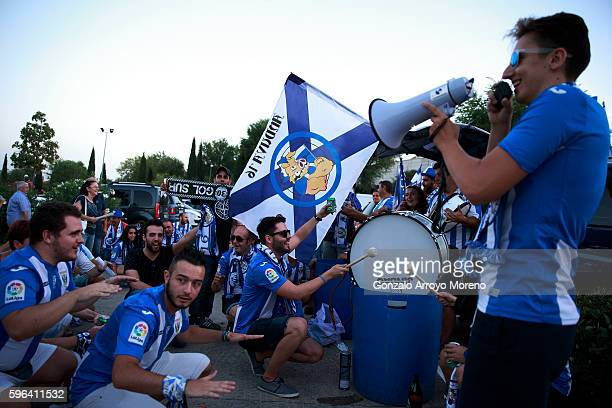 Leganes fans cheer their team at Estadio Municipal de Butarque outdoors prior to start the La Liga match between Club Deportivo Leganes and Club...