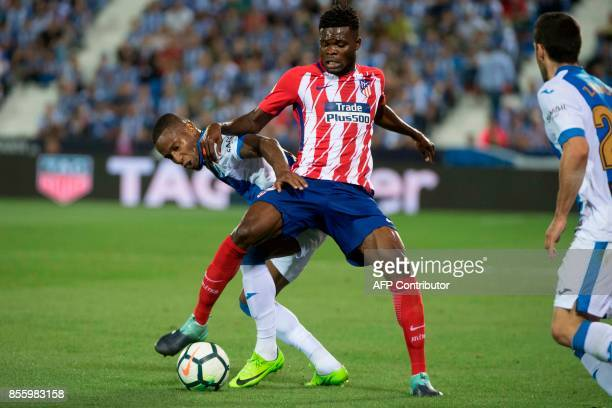 Leganes' forward from France Claudio Beauvue vies with Atletico Madrid's midfielder from Ghana Thomas Partey during the Spanish league football match...