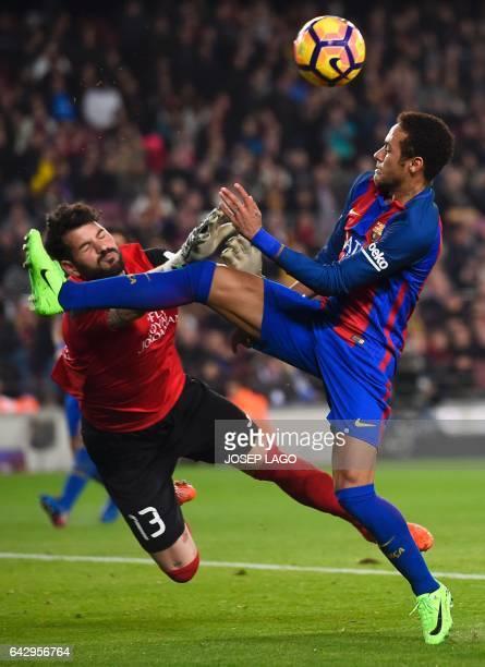 Leganes' goalkeeper Iago Herrerin vies with Barcelona's Brazilian forward Neymar during the Spanish league football match FC Barcelona vs CD Leganes...