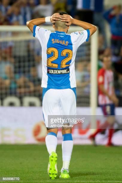 Leganes' Greek defender Dimitrios Siovas reacts during the Spanish league football match Club Deportivo Leganes SAD vs Club Athletic de Madrid at the...